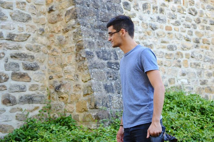 Standing Three Quarter Length Young Adult Brick Wall Casual Clothing Person Stone Wall Wall - Building Feature Architecture Person Day Thoughtful Handsome Outdoors Contemplation Luxembourg Streetphotography Echternach Nikon EyeEm Gallery Nikonphotography My Love My Man Nikon D3200