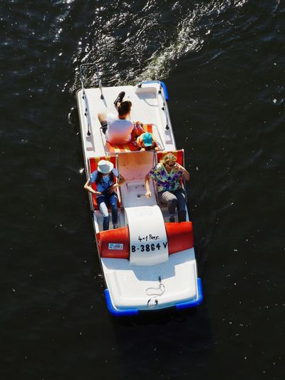 Children From Above  Iwantthatcamera Boat Day Floating On Water High Angle View Inflatable  Leisure Activity Lifestyles Mode Of Transportation Nature Nautical Vessel Orange Color Outdoors River Safety Transportation Travel Water Waterfront
