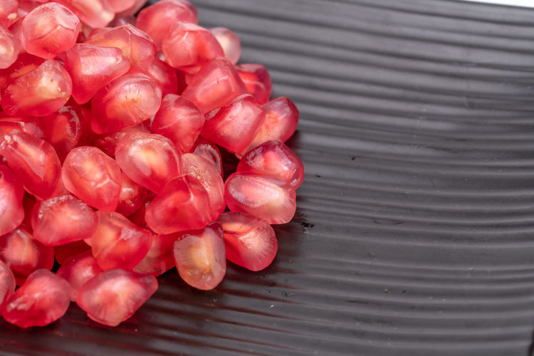 Attractive fruit in color, pomegranates Anticancer Barren Delicious Drought Resistant Food Fruit Heart Insect Repellent Mature Adult Medicinal Micronutrients Nutrition Pomegranate Pomegranate Seeds Red Red Heart Rich Seeds Supplement Temperate Zone Tropical Vitamins Water Food And Drink Freshness Wellbeing Healthy Eating No People Close-up Still Life Day Pattern Outdoors High Angle View Large Group Of Objects Nature Selective Focus Full Frame Table