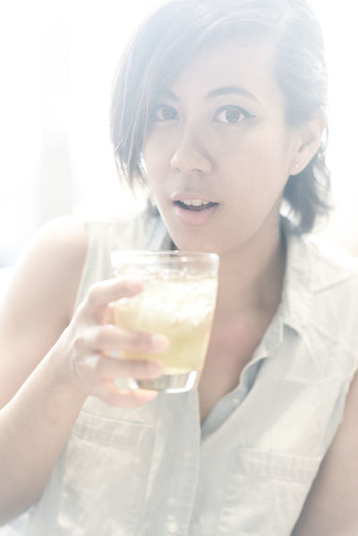 Cute woman holding drinking water Casual Clothing Close-up Cute Drinking Water Focus On Foreground Freshness Front View Girl Headshot Holding Leisure Activity Lifestyles Person Portrait Portrait Of A Woman Portrait Photography Refreshment Thailand The Portraitist - 2016 EyeEm Awards Water Drinks Woman