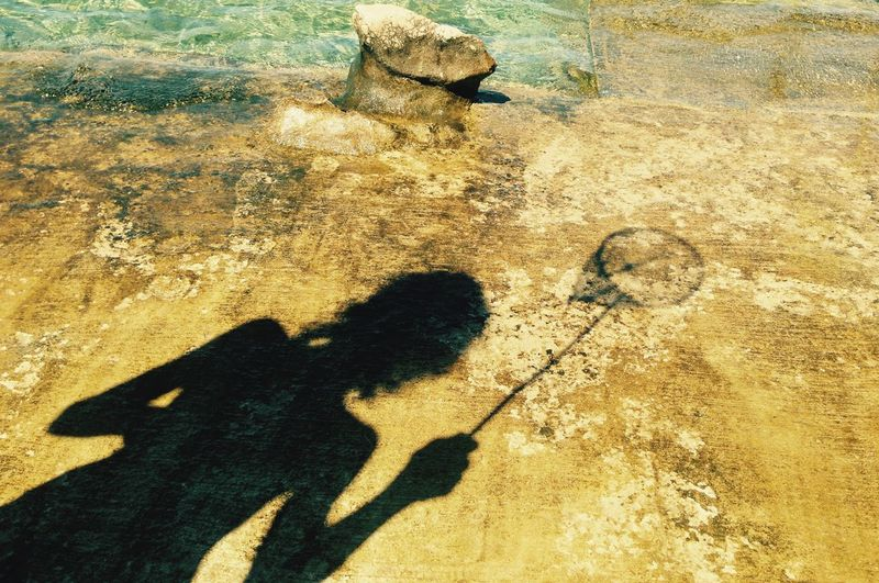 Shadow of man on water