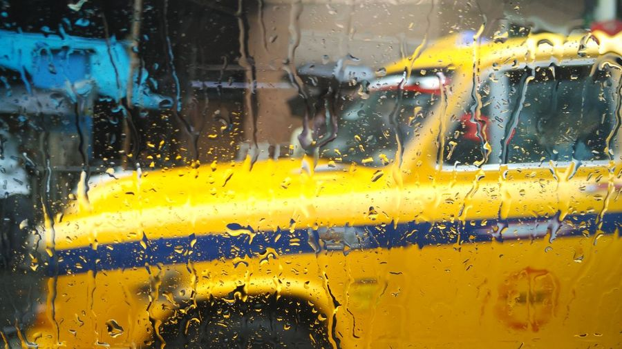 The yellow Taxi Car Day Drop Land Vehicle Mode Of Transport Outdoors Rain RainDrop Wet Window Yellow