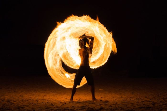 Performance Full Length Motion Dancer One Person Performing Arts Event Dancing Skill  Night Expertise Leisure Activity Yellow Silhouette Young Adult Acrobat Real People Beach Illuminated Fullmoon Full Moon Night  Full Moon Party Samui_thailand Samui Island