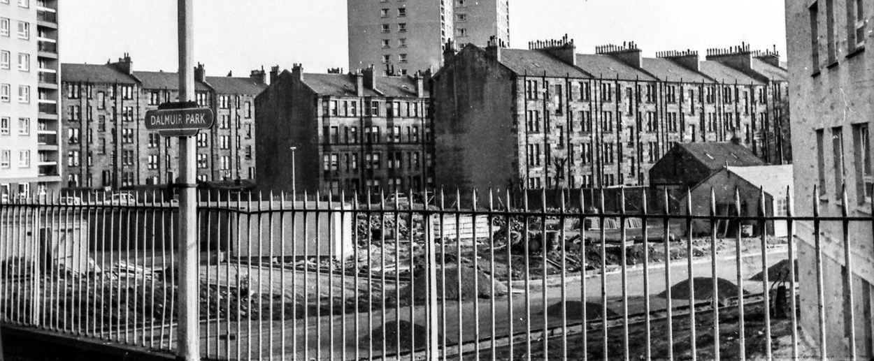 Dalmuir Park, Clydebank,Scotland about 1965 1960's Glasgow  Tenements Architecture Barrier Blackandwhite Boundary Building Building Exterior Built Structure City Communication Day Fence History House Metal No People Old Outdoors Railing Residential District The Past Window
