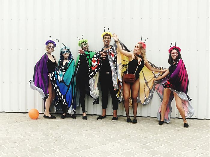 Colorful Gay Pride Costume In A Row Group Of People Full Length Wall - Building Feature Clothing Arts Culture And Entertainment Celebration Real People Love Is Love