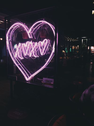Illuminated heart shape decoration on stage at night