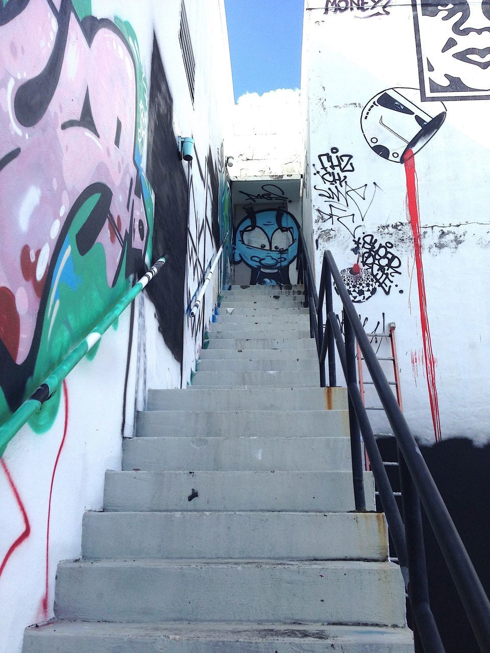 steps, graffiti, railing, steps and staircases, staircase, day, built structure, no people, architecture, outdoors