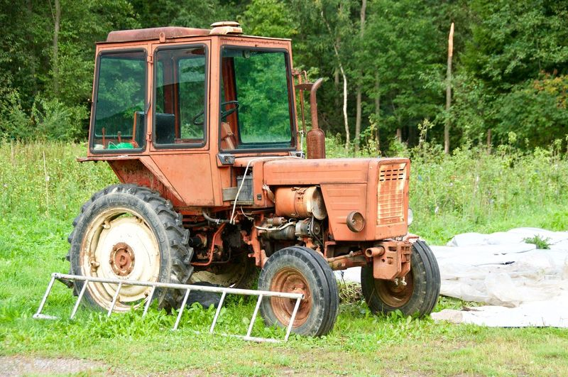 Old Tractor Suburban Green Color Cuntryside Cuntry Tractor Rural Scene Agriculture Stationary Land Vehicle Old-fashioned Field Agricultural Machinery Combine Harvester Tractor Farm Agricultural Equipment
