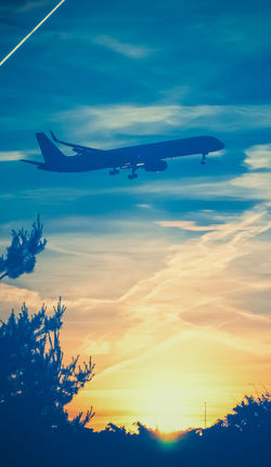 Colors Edited Sunlight Air Vehicle Airplane Airplane Wing Airplanes Blue Cloud - Sky Flying Mid-air No People Silhouette Sky Sunset Transportation