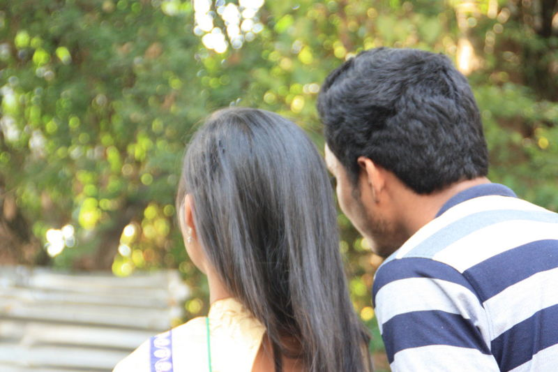 EyeEmNewHere. Two People Togetherness Love Heterosexual Couple Couple - Relationship Bonding Rear View Casual Clothing Romance Adults Only Affectionate Adult Couple Young Adult People Outdoors Men Nature Tree Women Mobile Conversations EyeEmNewHere
