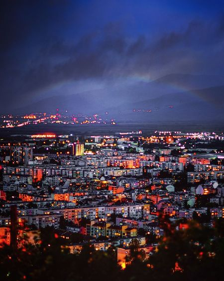 High angle view of illuminated cityscape against sky at dusk
