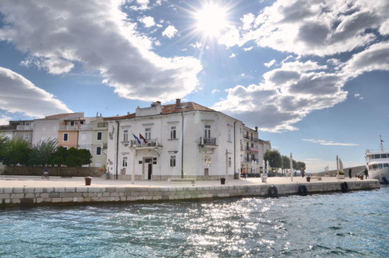 WATERFRONT IN PAG CROATIA #urbanana: The Urban Playground Sunlight Architecture Building Building Exterior Built Structure City Cloud - Sky Clouds And Sky Day House Motion No People Outdoors Sea Sky Sunlight Sunny Water Waterfront