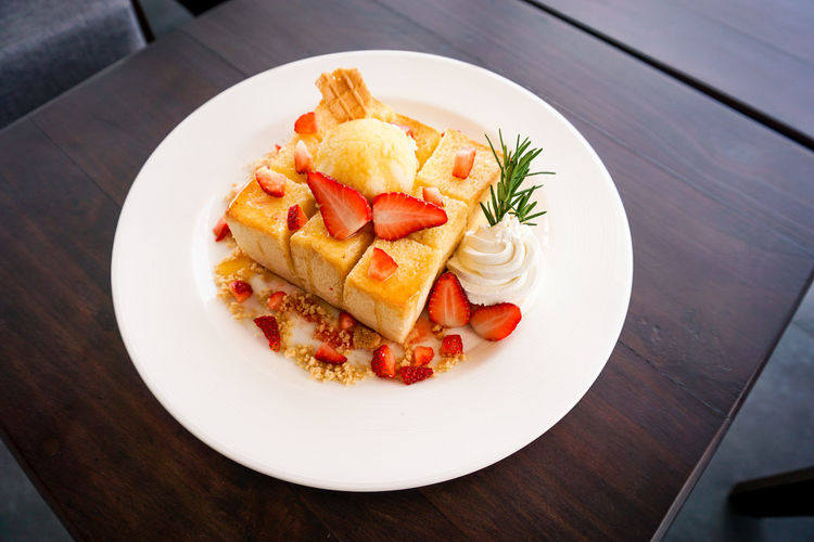 honey toast strawberry at coffee shop Thailand. Honey Toast Stawberry Cream Whipped Cream Fruit Red Rosemary Waffle Honey Bee Toast Butter Caramel Ice Cream Sumer Sweet Thailand Black White Lifestyles Restaurant Cafe Coffee Shop Cookie Crumble Crumble Cookie Vanilla Scoop Shape Table Food Plate Food And Drink Freshness Ready-to-eat Still Life Serving Size Wood - Material Indoors  High Angle View No People Wellbeing Close-up Healthy Eating Italian Food Pasta White Color Indulgence Business Temptation Garnish Snack