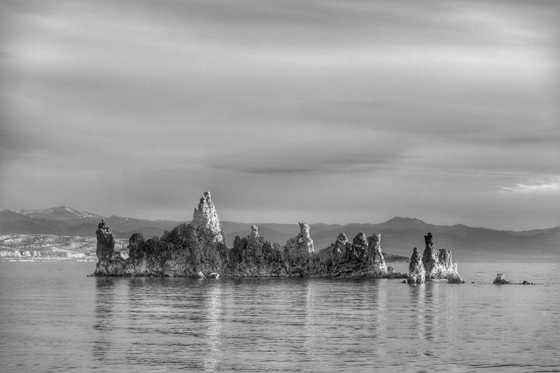 Black and white landscape of tufa formations in Mono Lake Landscape Black And White Tufa Mono Lake Water Sky Nature Sea Waterfront Day Cloud - Sky Holiday Beach Trip Vacations Outdoors Land Beauty In Nature