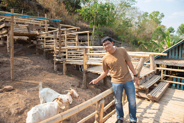 Animal Themes Animal Farm Farm Animal Eating Eating Backgrounds Nature Happy Holiday Enjoy Animals In The Wild Goat Goat Life Goat Eating Goat Farm Goat Feeding Domestic Animals Mammal Domestic Pets Man Casual Clothing Group Of Animals Real People Agriculture