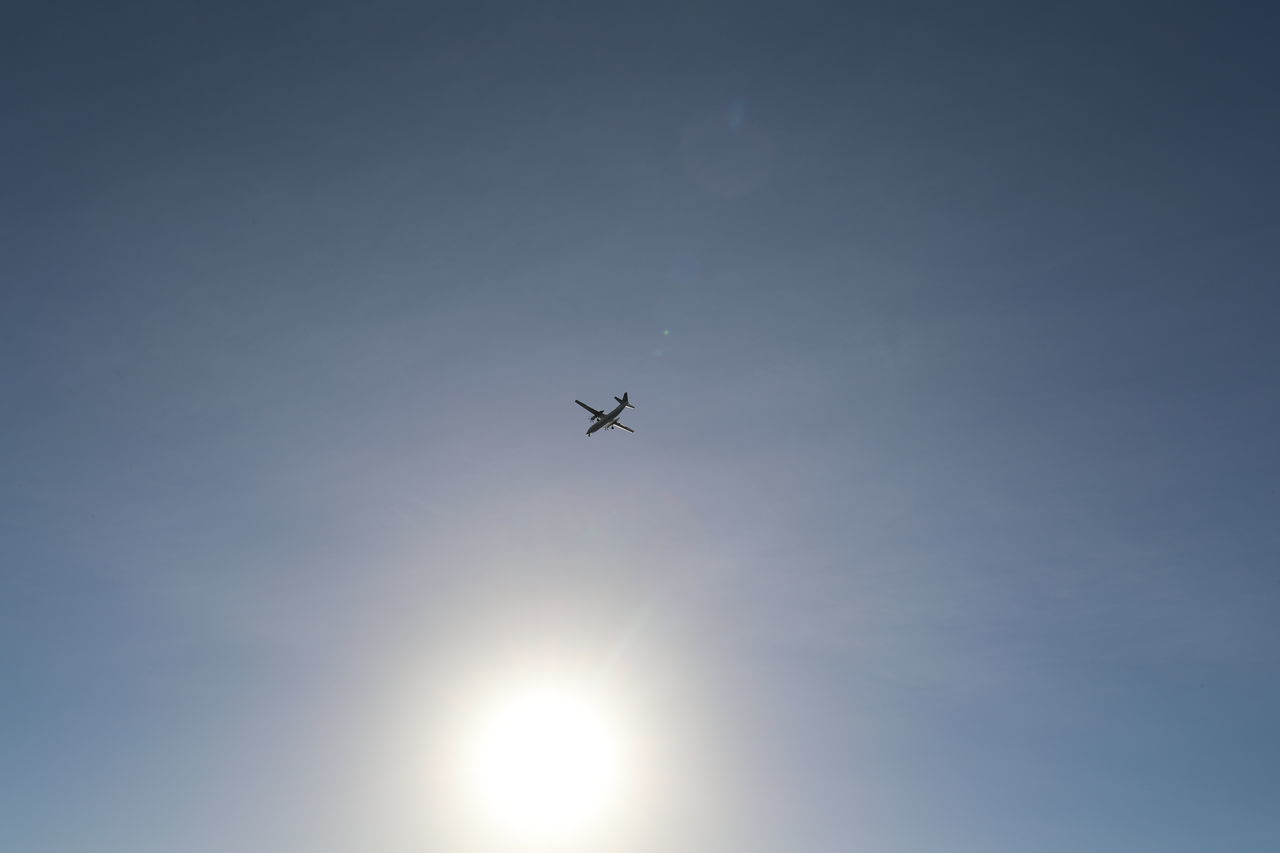 low angle view, flying, sky, transportation, airplane, sun, travel, outdoors, journey, no people, clear sky, nature, day