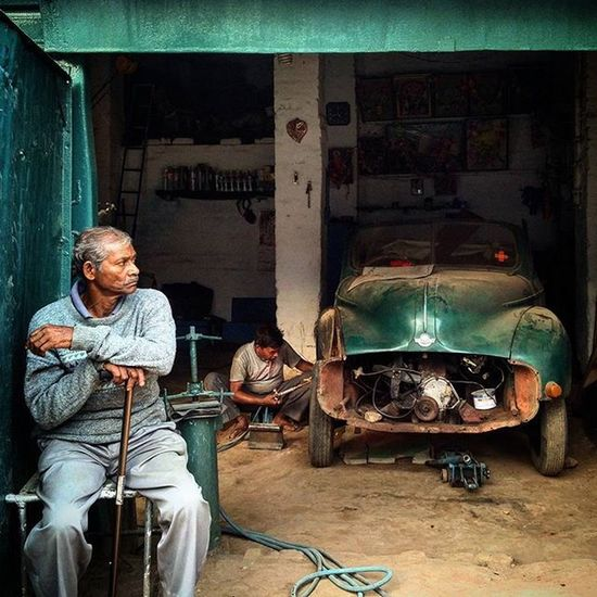 An Indian mechanic repairs a 1952 make Morris Minor at a garage In Ranchi, Jharkhand, India. The Morris Minor is a British car that debuted at the Earls Court Motor Show, London, on September 20, 1948. Designed under the leadership of Alec Issigonis, more than 1.3 million were manufactured between 1948 and 1972. Everydayeverywhere Everydayindia Dailylife Photojournalism Journalism Reportage Reportagespotlight Indiaphotoproject _soi Ranchi Jharkhand India ASIA Morris Morrisminor Vintage Vintagestyle Vintagecar Carstagram Huntgramcars