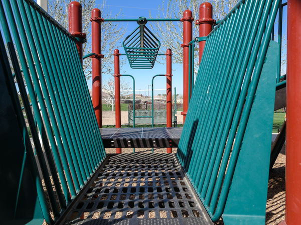 Playground in Suburban Development Architecture Built Structure Development Development/construction Feature Low Angle View Metal Modern Neighborhood Park Parks Playground Playground Equipment Railing Staircase Stairs Steps Steps And Staircases Structure Urban Geometry