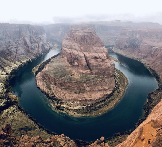 Aerial of river passing through canyon