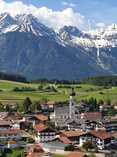 The views are beyond compare. Österreich du bist meine zweite heimat! Oesterreich Austria Tirol  Nordkette Mutters Tree Mountain Snow Snowcapped Mountain Town Mountain Peak House Place Of Worship Sky Architecture TOWNSCAPE Old Town Housing Settlement Bell Tower Farmland The Mobile Photographer - 2019 EyeEm Awards
