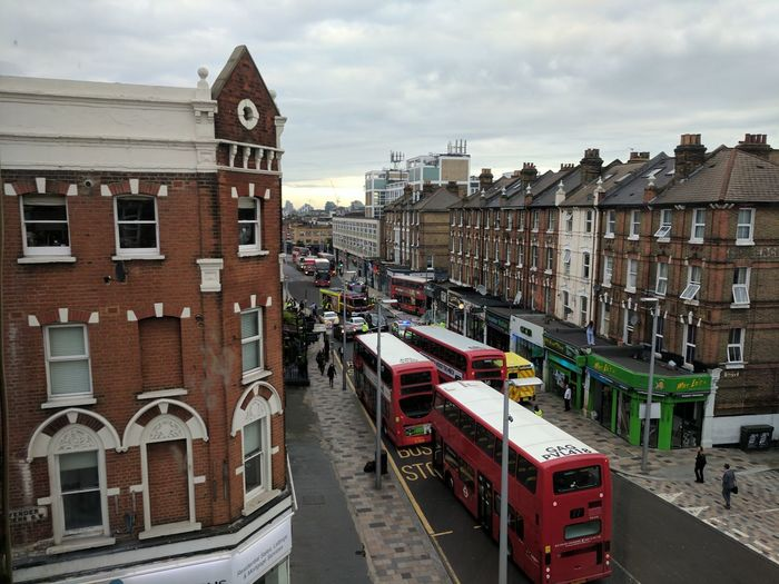 High angle view of double-decker buses on street amidst buildings in city
