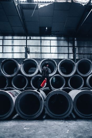 Person Walking On Concrete Pipes