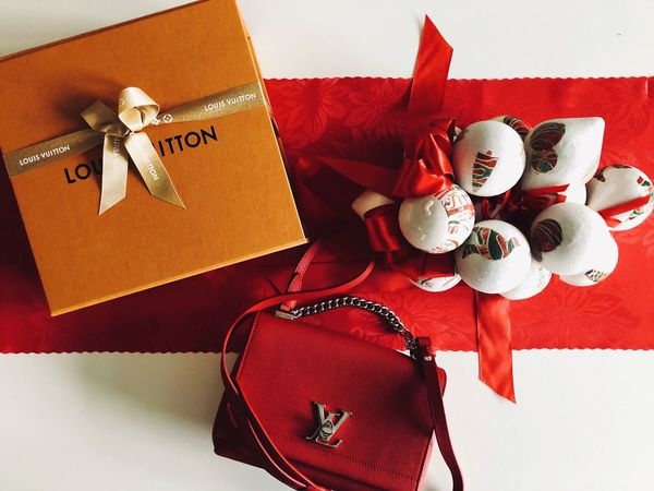 Luis Vuitton Purse Gift Box - Container Still Life Indoors  High Angle View Ribbon - Sewing Item Christmas Present No People Red Directly Above Christmas