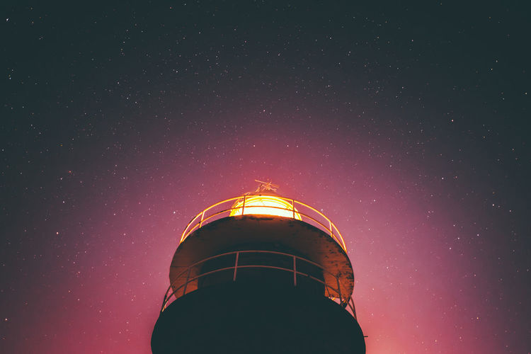 lighthouse Sky Astronomy Low Angle View Night Star - Space Built Structure Architecture Building Exterior Space Nature No People Galaxy Building Star Star Field Tower Outdoors Illuminated Science Scenics - Nature Purple Space And Astronomy Lighthouse