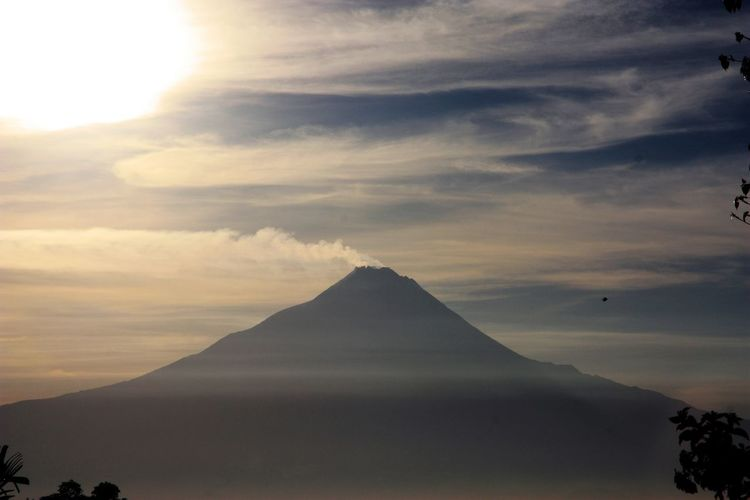 Scenic View Of Volcano Against Sky During Sunset