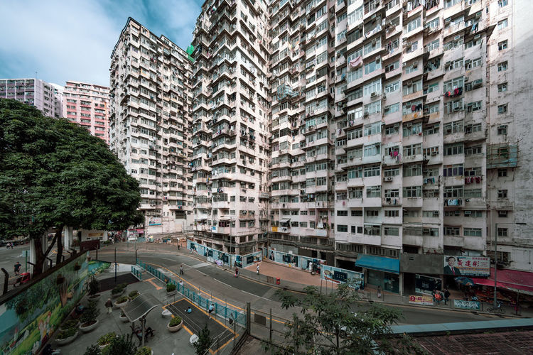 High angle view of street amidst buildings in city, quarrybay, hong kong.