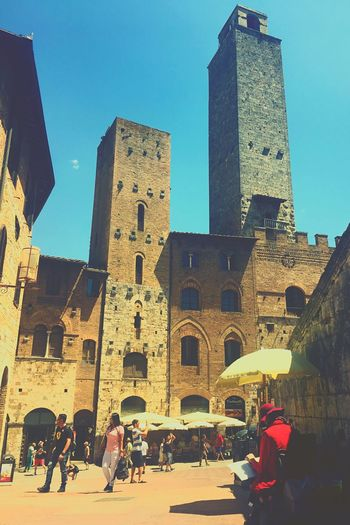 Beautiful day at San Gimigniano ☺️ Architecture Built Structure Building Exterior Real People Men Clear Sky Day Travel Destinations Lifestyles Sky Women Blue Outdoors Low Angle View The Street Photographer - 2017 EyeEm Awards EyeEm Gallery EyeEm Vacations Live For The Story BYOPaper! History Brick Wall City People Adult Live For The Story BYOPaper! The Street Photographer - 2017 EyeEm Awards The Great Outdoors - 2017 EyeEm Awards The Architect - 2017 EyeEm Awards The Photojournalist - 2017 EyeEm Awards EyeEmNewHere Neon Life The Street Photographer - 2018 EyeEm Awards