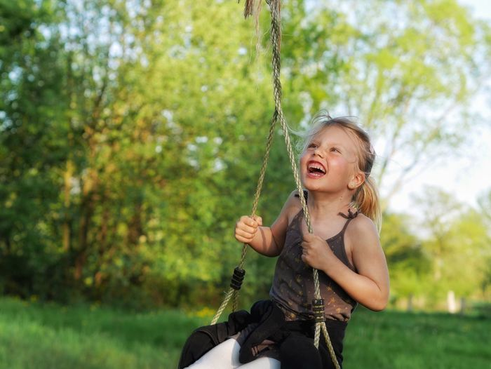 Portrait of young girl on swing
