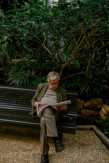 morning paper Newspaper Reading Reading Newspaper Morning Paper Botanical Garden Tree Trees Old Man Portrait Of An Old Man Elderly Man Bench Tree Full Length Sitting