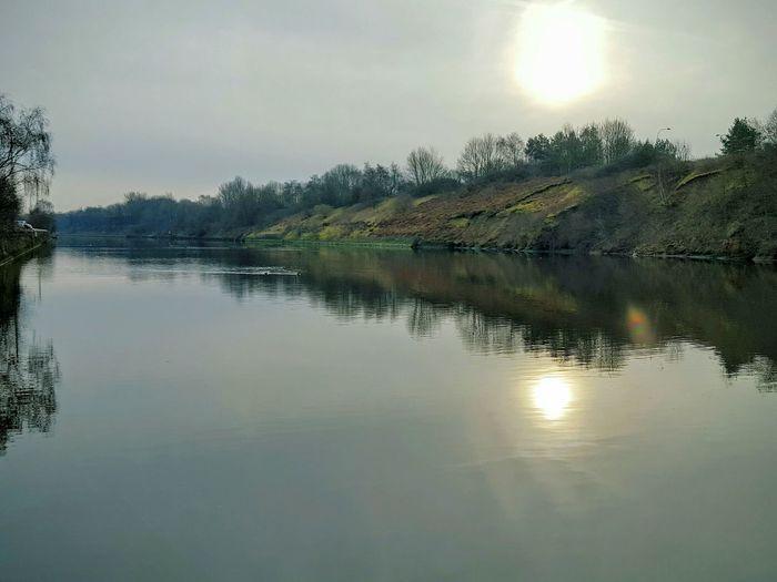 Wintertime Hazy Shade Of Winter Sun Reflection On Water Still Water Riverbank Sunrise @ Wigg Island
