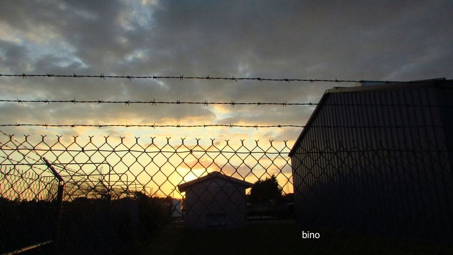 Out Walking My Neighborhood Barbed Wire Sunset Over The Armory Building Silhouette Clam River Walkway Cadillac Michigan