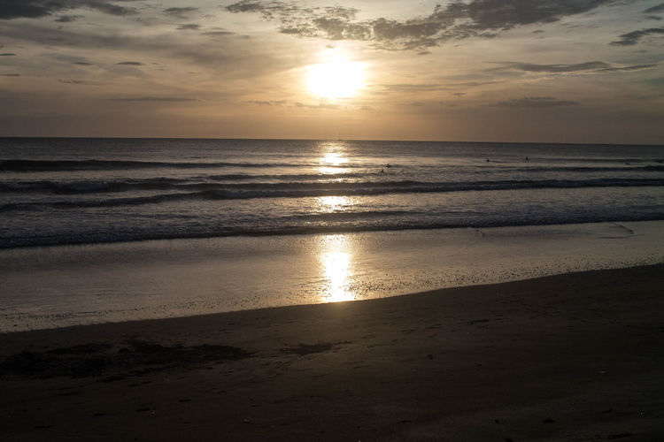 Costa Rican Sunset Surf Beach Beauty In Nature Cloud - Sky Horizon Horizon Over Water Idyllic Land Landscape Motion Nature No People Ocean Outdoors Reflection Sand Scenics - Nature Sea Sky Sun Sunset Tranquil Scene Tranquility Water Wave