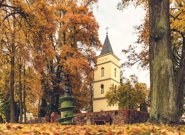 Church in autumn mood Architecture Autumn Autumn Collection Autumn Colors Autumn Leaves Building Exterior Built Structure Church Day Growth Low Angle View Nature No People Outdoors Sky Tree Village Warm Colors Yellow Leaves