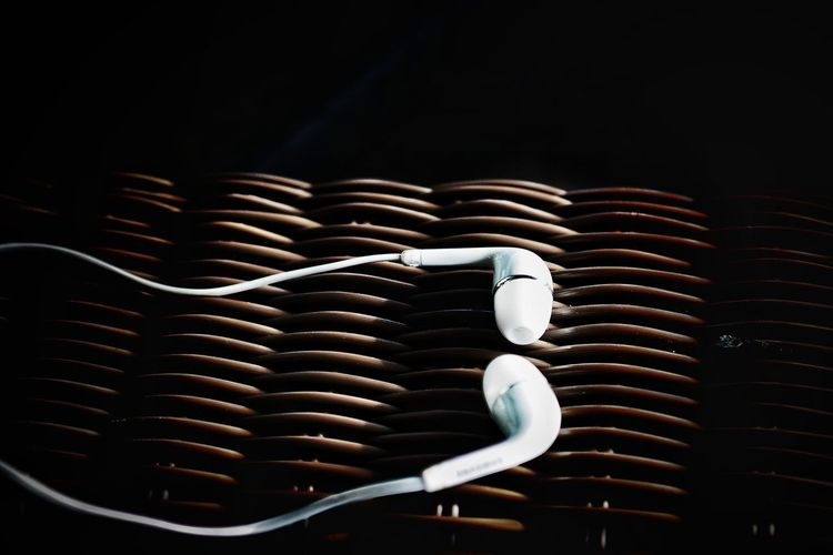 Close-up of headphones on wicker basket