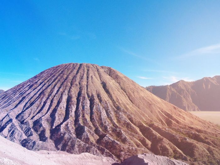 Mountain Bromo area in Indonesia Geology Beauty In Nature Nature Mountain Tranquility Tranquil Scene Physical Geography Scenics Day Sky Landscape Outdoors No People Volcano ASIA Asian  Landmark Travel Destinations Sunlight Sunshine ☀ Blue Sky Filtered Image