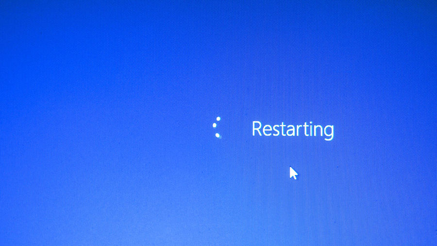 Begin Restart Restart The Computer. Blue Blue Background Clear Sky Close-up Communication Computer Icon Copy Space Full Frame Illuminated Indoors  Information Message No People Restarting Sign Sky Symbol Technology Text Western Script White Color