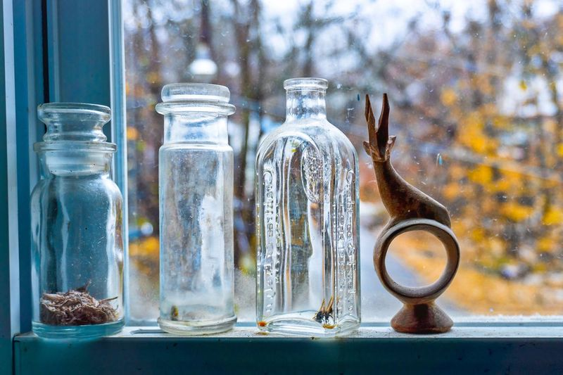 Mom's attic window Still Life Photography StillLifePhotography Still Life Mom's House EyeEm Selects Container Glass - Material Bottle No People Still Life Focus On Foreground Transparent Jar Close-up Group Of Objects Window My Best Photo