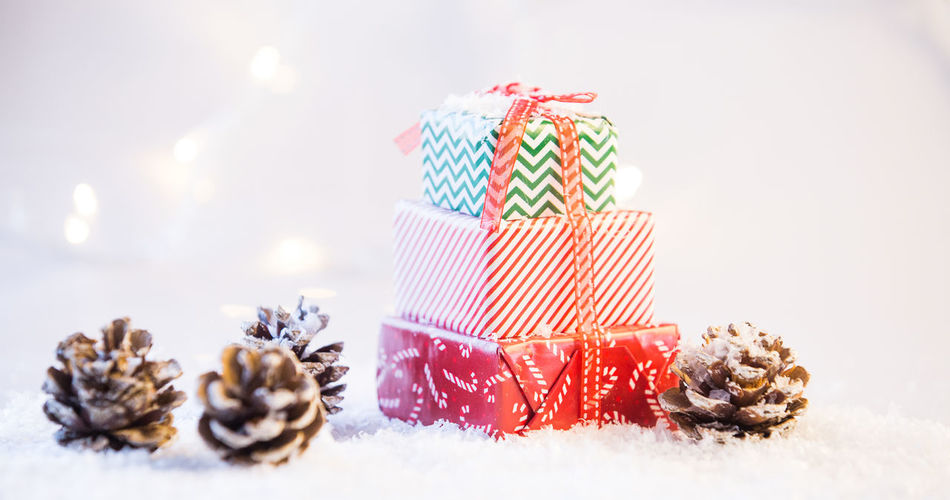 Close-up of cake on table against white background