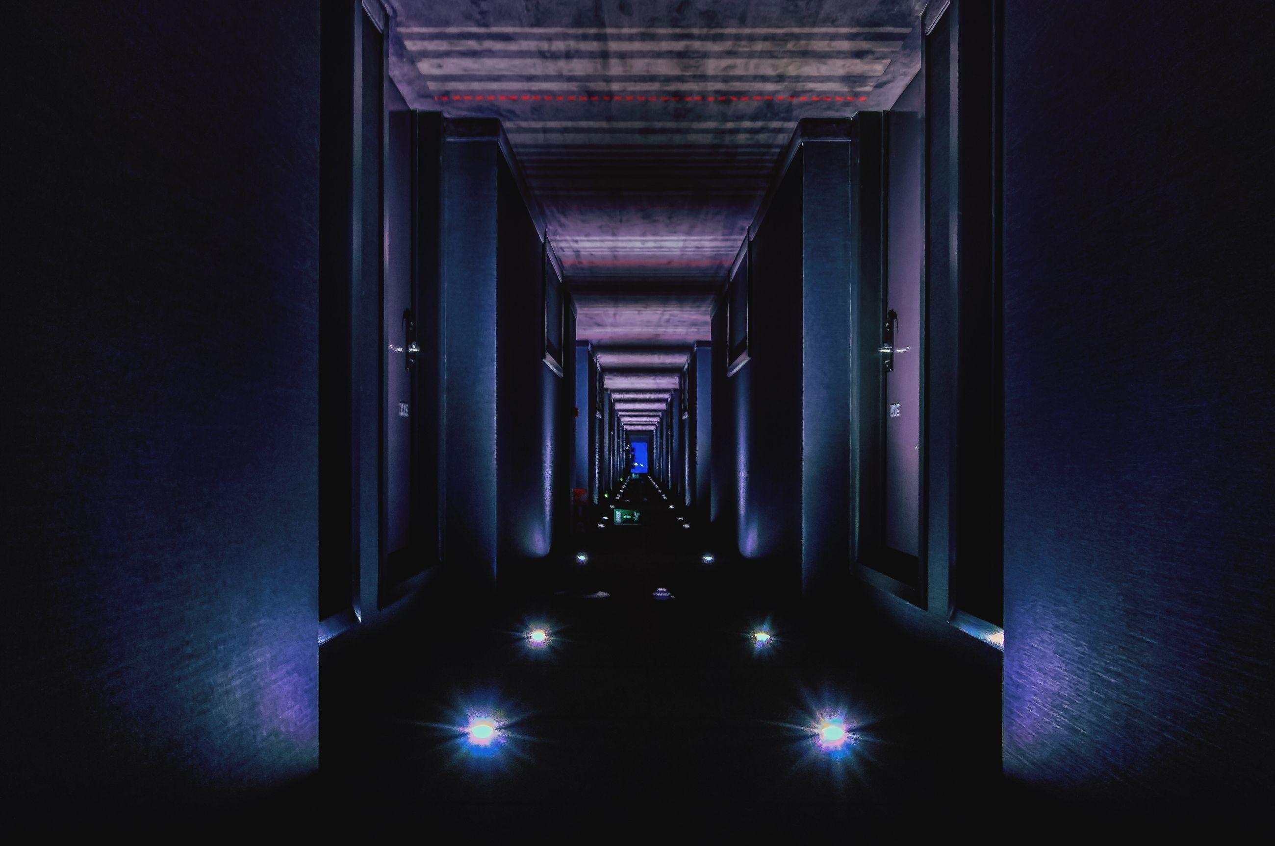 Upside down image of illuminated hotel passage