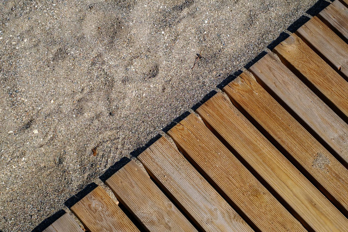 Wooden floor on sandy beach Beach Life Floor Patterns Sandy Lands SandyBeach Architecture Close-up Day High Angle View No People On Beach Outdoors Pattern Plank Sand Dune Sandy Beach Textured  Timber Wood - Material Wood Floor Wood Paneling Wooden Floor
