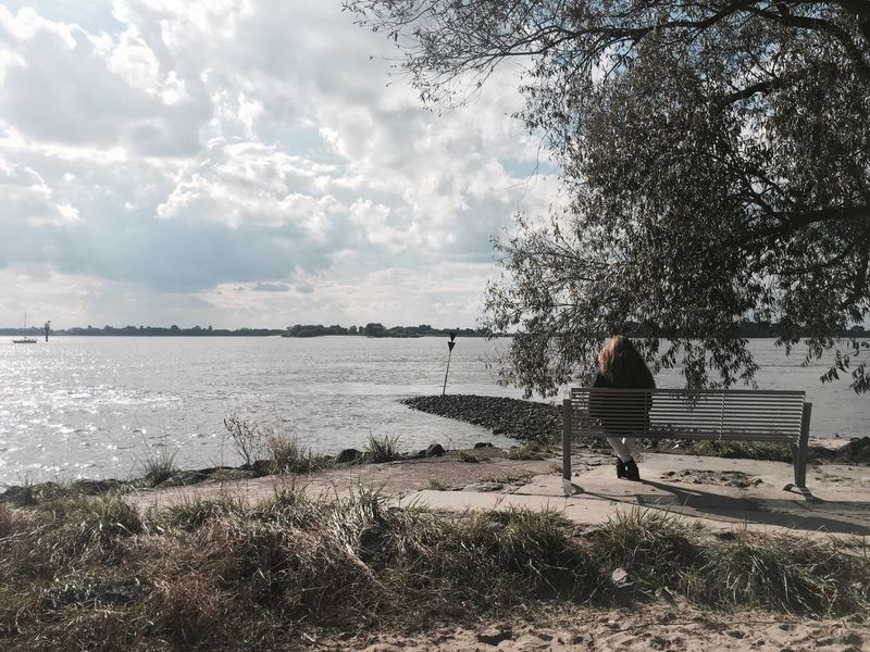 Hamburg Elbe Elbe River Water Reading Parkbank Parkbench Parkbenches Woman Tree Sky Tranquil Scene Grass Rear View Cloud - Sky Tranquility Full Length Riverbank Scenics Nature Cloud Outdoors Day Remote Non-urban Scene Vacations Summer Solitude