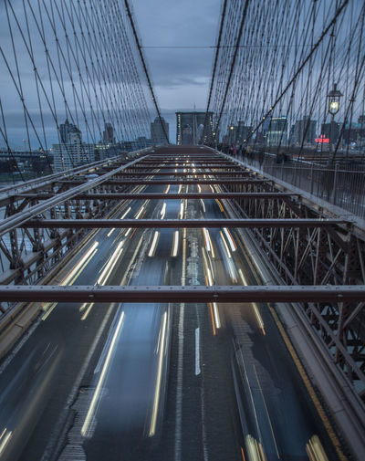 High Angle View Of Light Trails On Bridge In City Against Sky