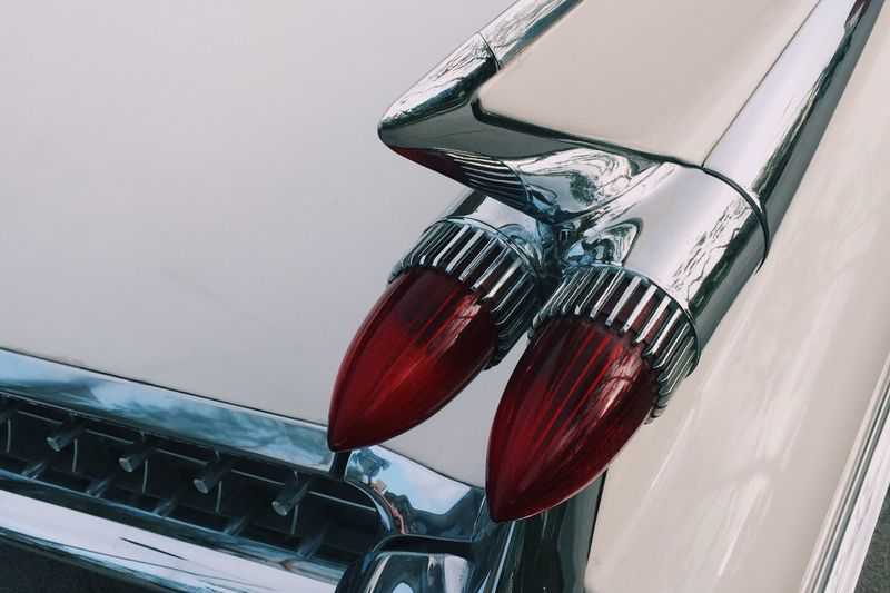 Close-up of vintage car red headlights
