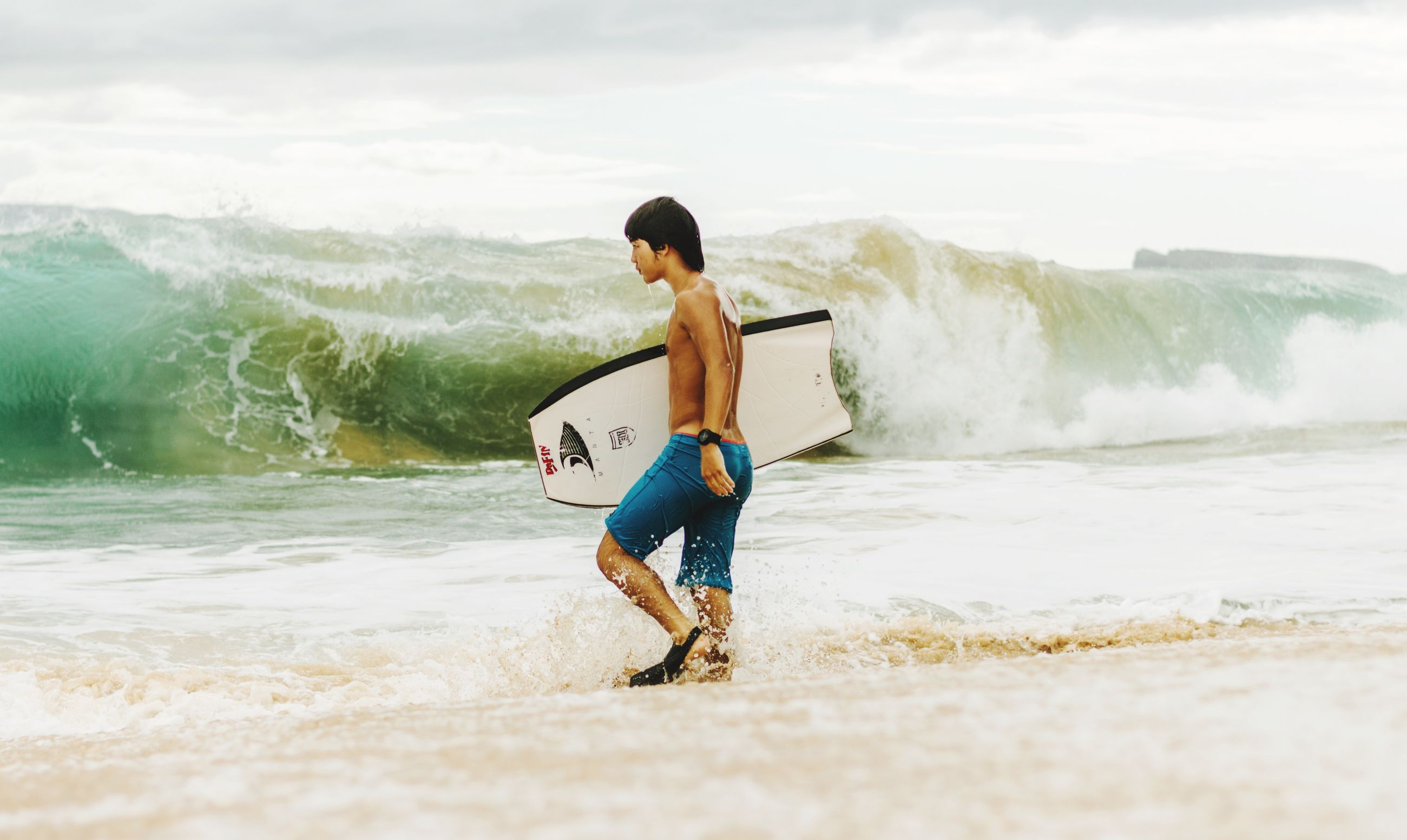 water, full length, leisure activity, lifestyles, sea, beach, vacations, casual clothing, sky, person, shore, wave, motion, enjoyment, shirtless, young men, boys, sand