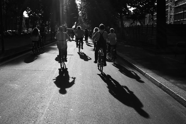The City Light Shadow Silhouette Lifestyles Large Group Of People Sunlight Leisure Activity Real People City People Outdoors Bike Bikers Streetphotography Streetphoto_bw Street Photography Black And White Blackandwhite Black & White Men Adults Only Only Men Tree Adult Friendship