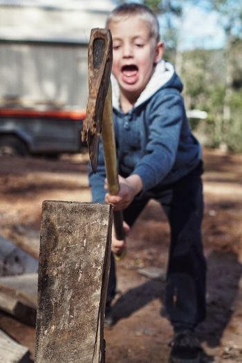 Child chopping wood